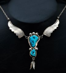Vintage Navajo pawn silver wings necklace with Sleeping Beauty turquoise.
