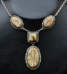 Sterling Navajo four-stone ribbon turquoise pendant necklace.