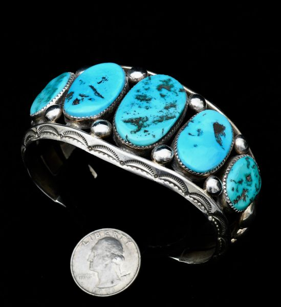 Magnificent Navajo pawn row cuff with aging Sleeping Beauty turquoise.