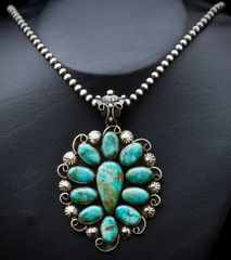 Larger eleven-stone Sterling and turquoise cluster pendant by Chimney Butte.