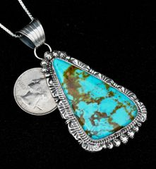 Sterling Navajo pendant (with chain) with Kingman turquoise, by Gilbert Tom.