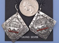 Vintage Navajo diamond-shaped earrings stamped with Navajo hogan and red coral insert