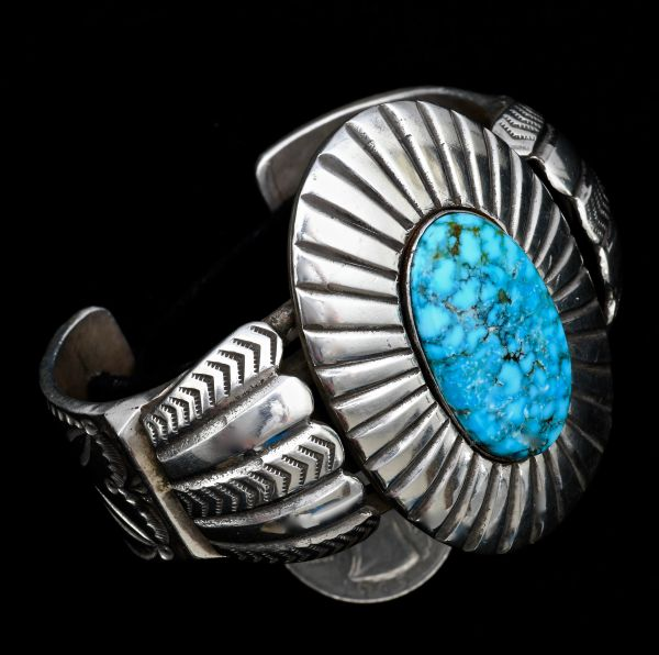 Heavy silver Navajo pawn cuff with new water-web Kingman turquoise stone.