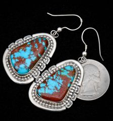 Sterling Navajo Kingman turquoise earrings with copper matrix.