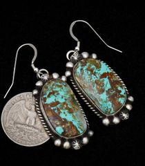 "Navajo Sterling earrings with hand-picked Kingman turquoise crafted in ""old-style"" patina."