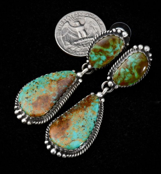 Navajo two-piece Sterling earrings with hand-picked turquoise stones.