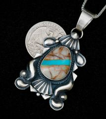 Navajo ribbon turquoise pendant with repousse' silverwork.