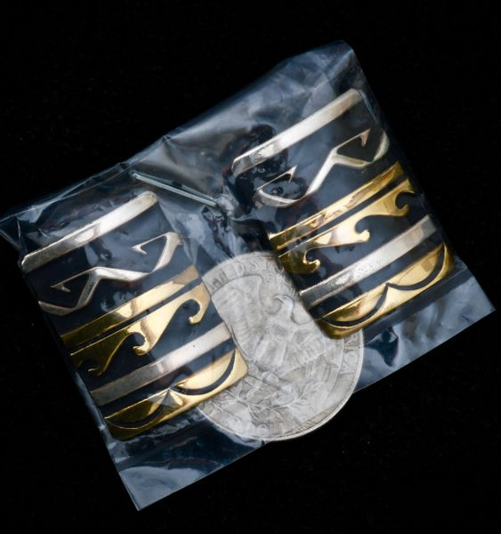 Uncirculated, original, signed Tommy Singer goldcraft earrings.