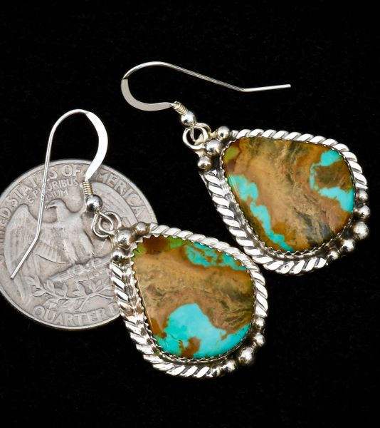 Navajo turquoise earrings with predominate copper matrlx.