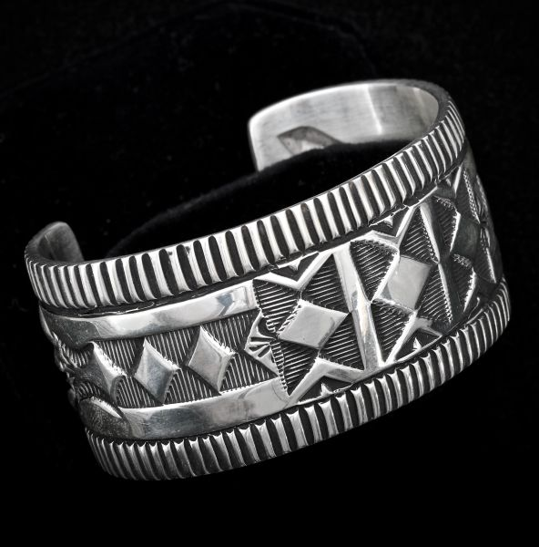 Dead-pawn heavy silver 7.25-inch circumference Navajo cuff, by Elvira Bill.