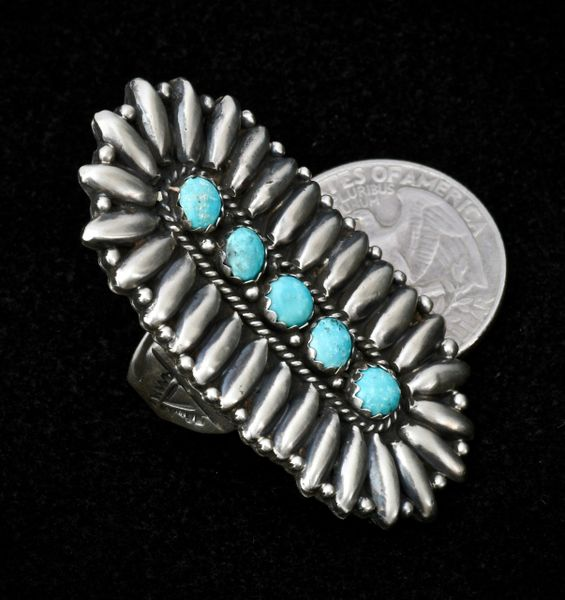 Sterling Navajo ring with 28 pieces of reverse-stamped repousse'—size 6.5.