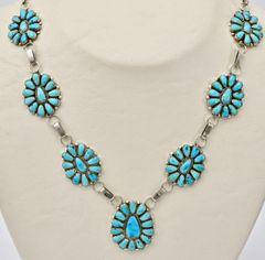 Dead-pawn seven-pendant Navajo cluster necklace.