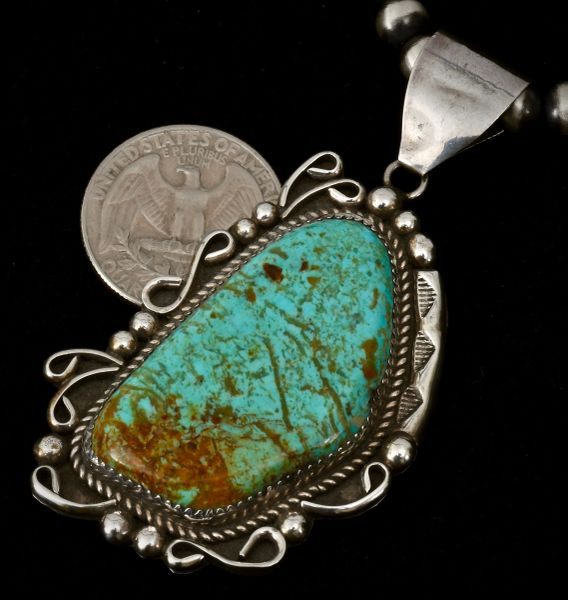 Dead-pawn Sterling Navajo pendant with Royston, Nevada turquoise.