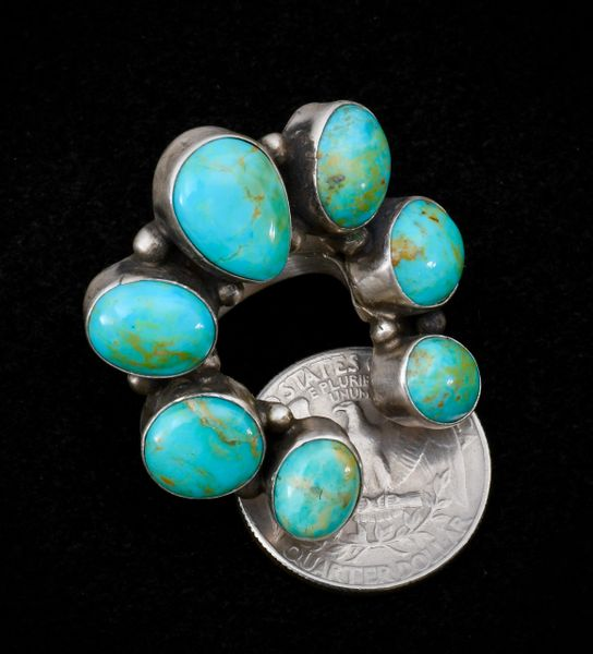 Size 6 Navajo Najo ring with seven turquoise stones. #1297