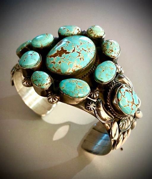 "Sterling Navajo cuff with eleven original ""old"" No. 8 Mine turquoise stones, by Gilbert Tom.—SOLD!"