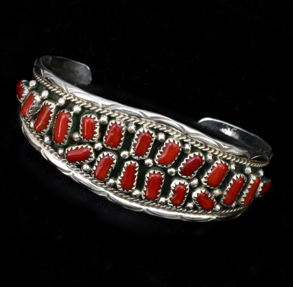 Smallish wrist size Navajo cluster cuff with Mediterranean red coral, by Victoria Yazzie..
