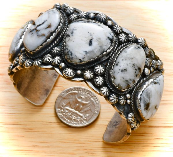 Heavy silver Navajo cuff with five White Buffalo stones, by Gilbert Tom. #1306
