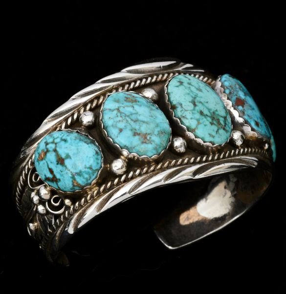 Five-stone Navajo row cuff with Kingman turquoise; 7-inch circumference.
