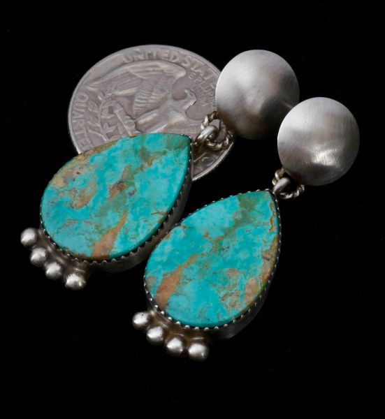 Two-piece Navajo earrings with old-style patina and Turquoise Mountain turquoise.