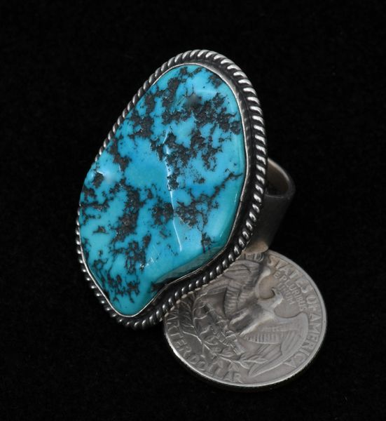 Navajo size 7.5 Sterling and Sleeping Beauty turquoise ring.