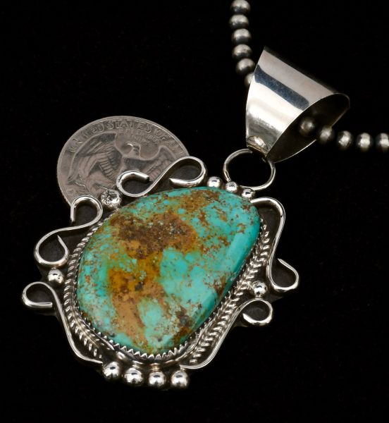 Navajo dead pawn turquoise pendant by Kirby Nez; bead chain optional.