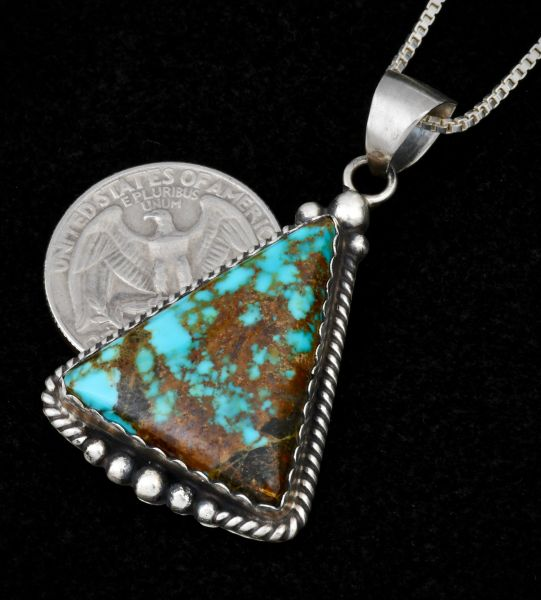 Colorful Elouise Kee triangular Kingman turquoise pendant with chain.