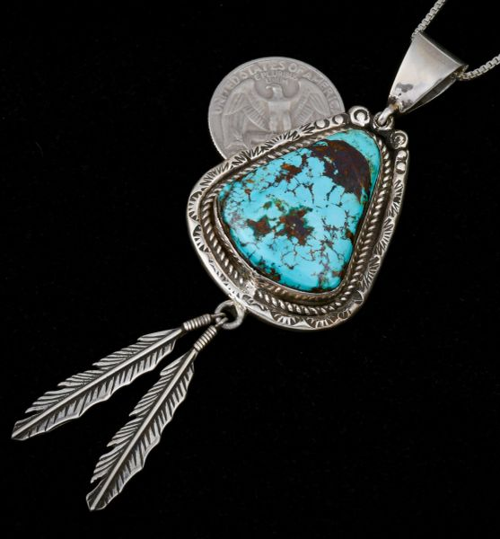 Navajo dead-pawn turquoise feathered pendant and chain.