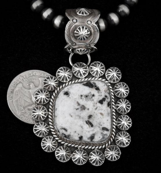 Navajo White Buffalo pendant with ornate silverwork and large ornate bale (Navajo pearl beads optional).