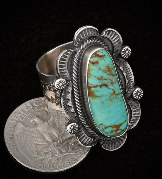 Size 9.25 Navajo Royston turquoise ring with hand-stamped bezel and band in old-style patina.