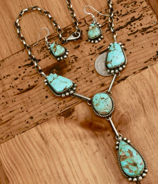 Navajo pendant necklace with matching earrings by Augustine Largo.