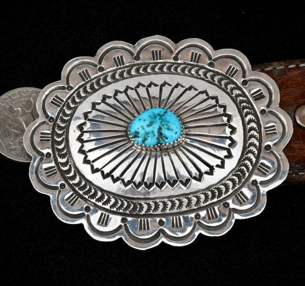 Carson Blackgoat hand-stamped Sterling Navajo belt buckle with Sleeping Beauty turquoise.