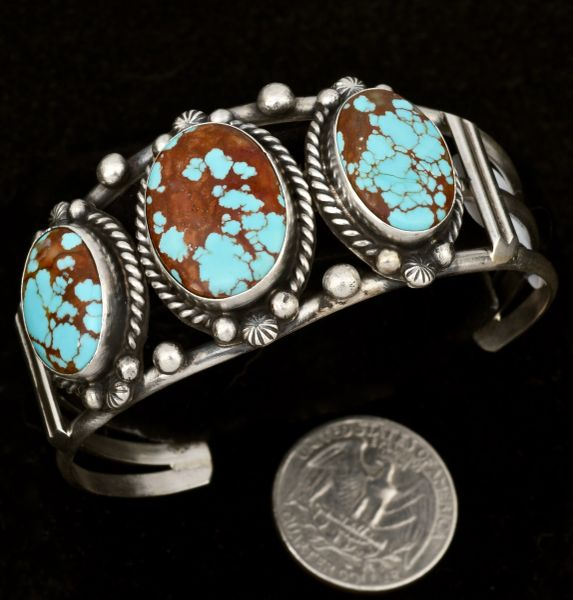 Navajo triplet cuff with No. 8 Mine turquoise measuring 6.5-inch inside circumference, by Augustine Largo.