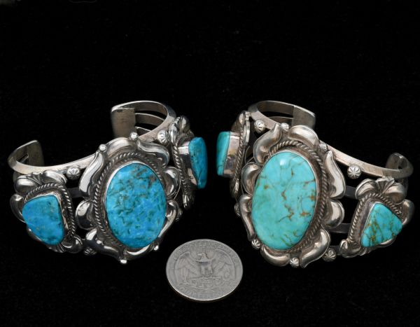 Small wrist size (5 and 1/2-inch total wrist circumference) triplet Navajo cuff with dark blue Kingman turquoise, by Gilbert Tom—pictured on the left.
