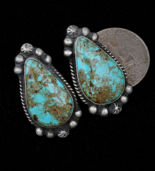 Navajo earrings in old-style patina with Kingman turquoise, by Augustine Largo.