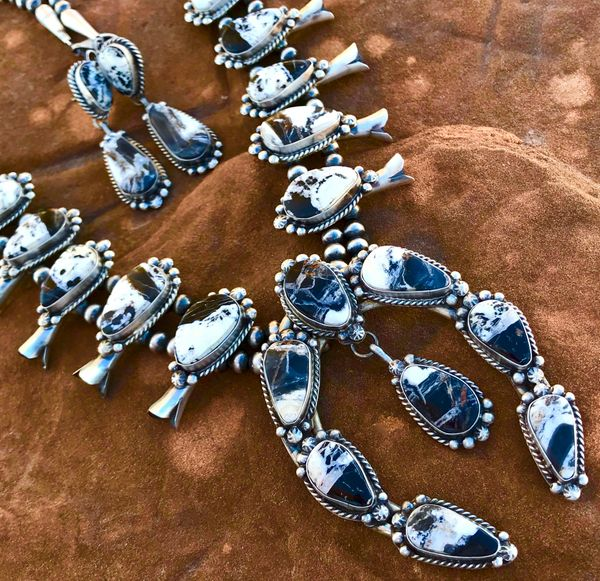 Sterling Navajo squash-blossom necklace with hand-picked, high-matrix white buffalo, and matching two-piece earrings.
