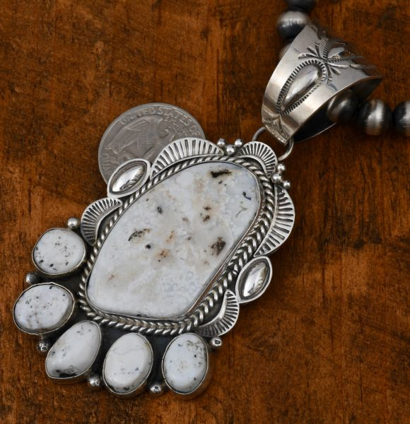 """Large six-stone White Buffalo Navajo pendant by Michael Spencer (shown with optional 8-mm, 20-inch Sterling Navajo """"pearls)."""""""