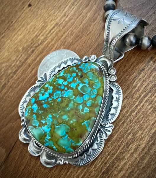 Trophy micro-web Kingman turquoise Navajo pendant by Gilbert Tom (shown with optional 6mm, 20-inch Navajo 'pearl' bead chain). #1474