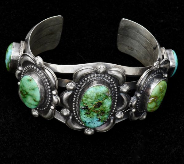 Navajo repousse' cuff with five Royston, turquoise stones. #1496