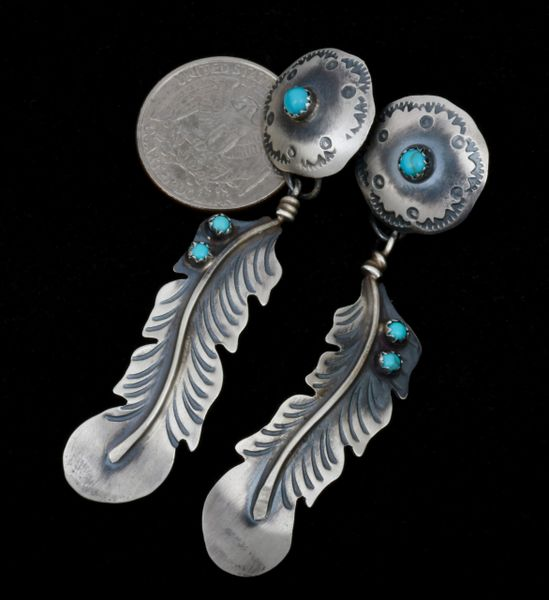 Two-piece Navajo three-inch feather earrings in old-style patina. #1509