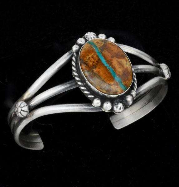 Navajo cuff with single Royston ribbon turquoise stone with 6.25-inch total inside circumference.