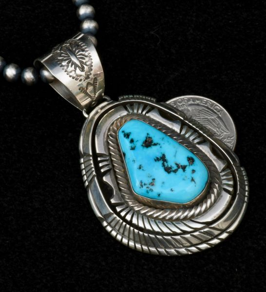 Two-inch, five-layer Sterling bezel pawn pendant with Sleeping Beauty turquoise by Rob Livingston (shown with optional 5mm, 20-inch burnished Sterling Navajo 'pearl' bead necklace). #1519