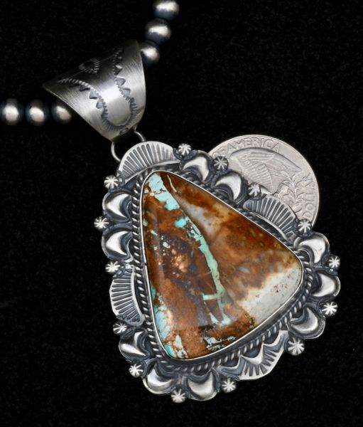 Navajo hand-stamped, old-style patina pendant with reverse-stamped repousse' and a hand-picked ribbon turquoise stone (shown with optional 5mm, 22-inch Sterling Navajo 'pearls'). #1561