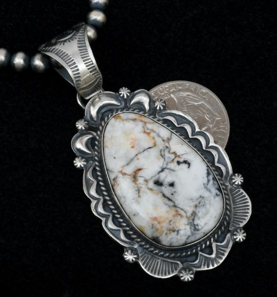 """Two-inch hand-picked colorful White Buffalo Navajo hand-stamped pendant with repousse' by Robert Shakey. #1603 (Shown with optional 5mm, 22-inch burnished Navajo """"pearls"""")"""