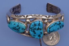 Navajo dead-pawn triplet cuff with Sleeping Beauty turquoise.