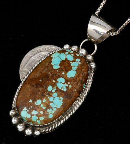 Alfred Martinez' No. 8 Mine turquoise Navajo pendant.