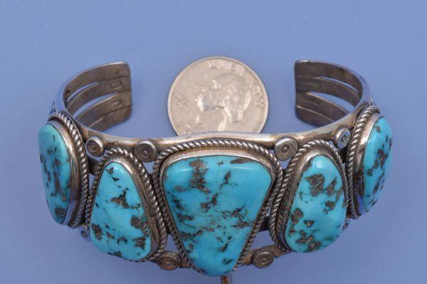 Navajo dead-pawn five-stone Sleeping Beauty cuff