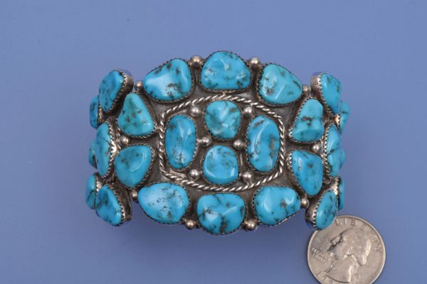 Navajo pawn cuff with 26 Sleeping Beauty turquoise stones.