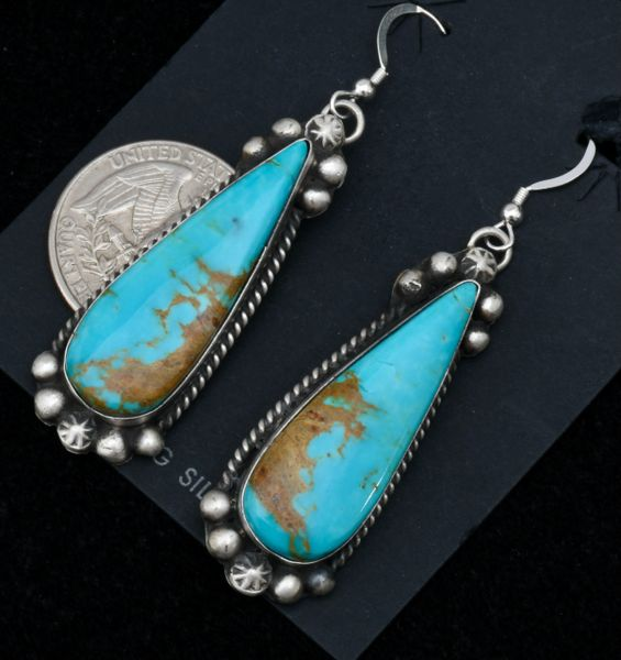 Elongated Navajo earrings with Kingman, Arizona turquoise, by Augustine Largo.