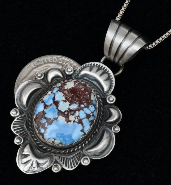 Golden Hills turquoise Navajo pendant surrounded by repousse' silver-work by Robert Shakey. #1687