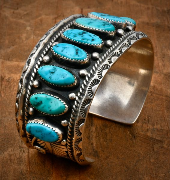 Dead-pawn Navajo row cuff with ten Sleeping Beauty turquoise stones. #1700